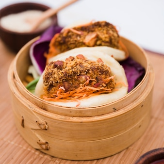 Close-up of traditional food gua bao in bamboo steamer
