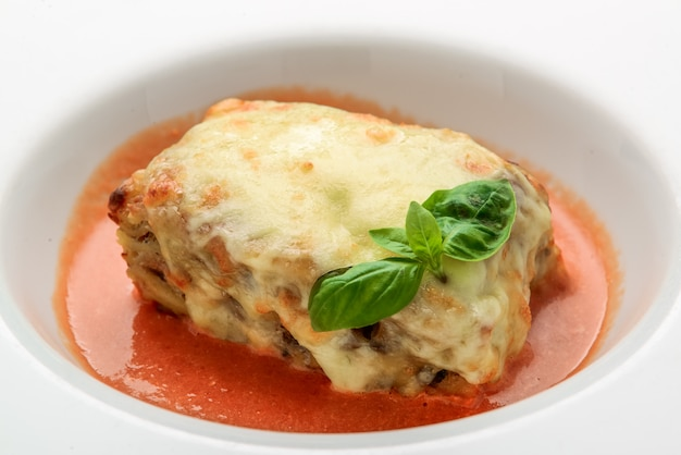 Close-up of a traditional lasagna made with minced beef bolognese sauce topped