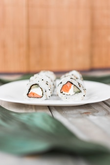 Close-up of traditional sushi on plate over table