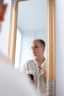Close up transgender looking in the mirror