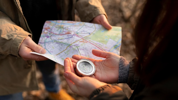 Close up travelers with map and compass