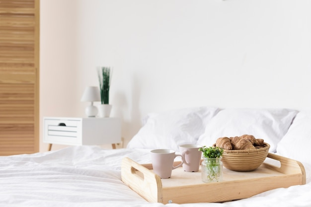 Close-up tray with breakfast on bed