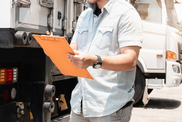 Close up truck driver holding clipboard
