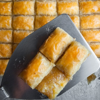 Close-up turkish baklava dessert made of thin pastry, nuts and honey