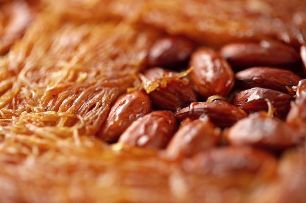 Close up of turkish baklava dessert with honey and nuts