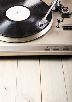Close-up of turntable vinyl record player on wooden table