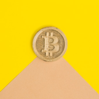 Close-up of two bitcoins over the dual background