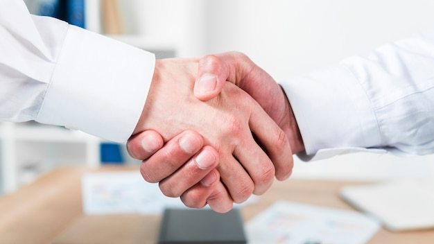 Close-up of two businessman shaking hands