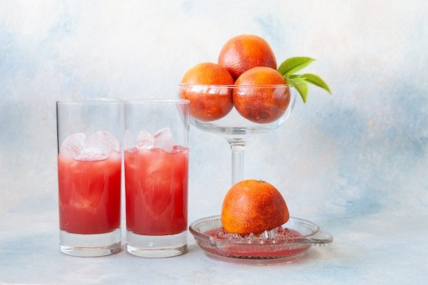 Close-up of two glasses of cold fresh blood orang