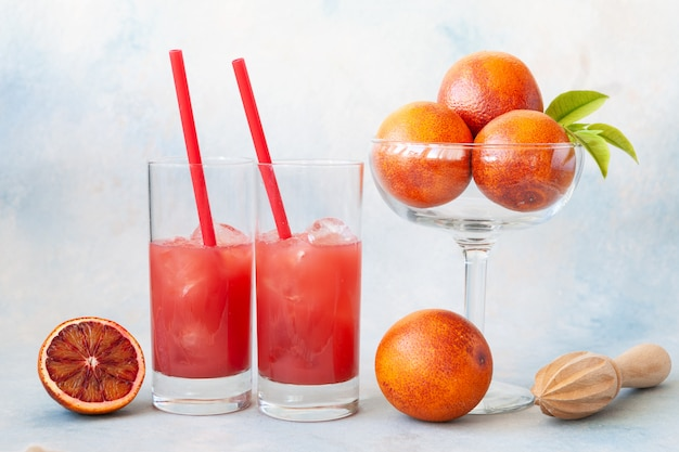 Close-up of two glasses of cold fresh blood orange