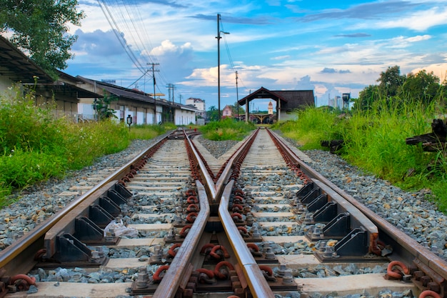 Close up two railway tracks merge together  at chiangmai , thailand
