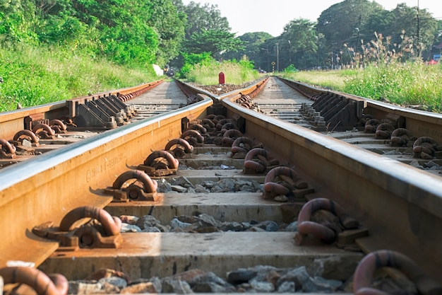 Close up two railway tracks merge together.