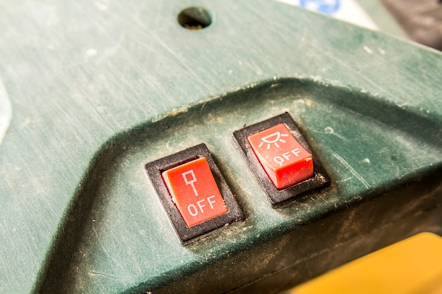Close-up of two small switches on and off