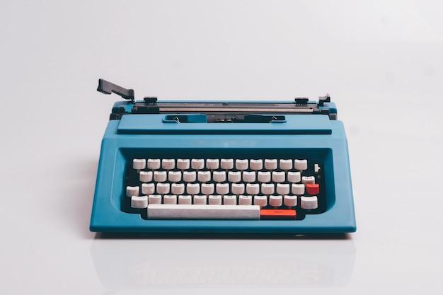 Close up typewriter on white background.