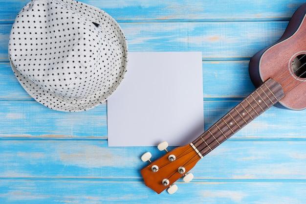 Close up of ukulele on blue wooden background