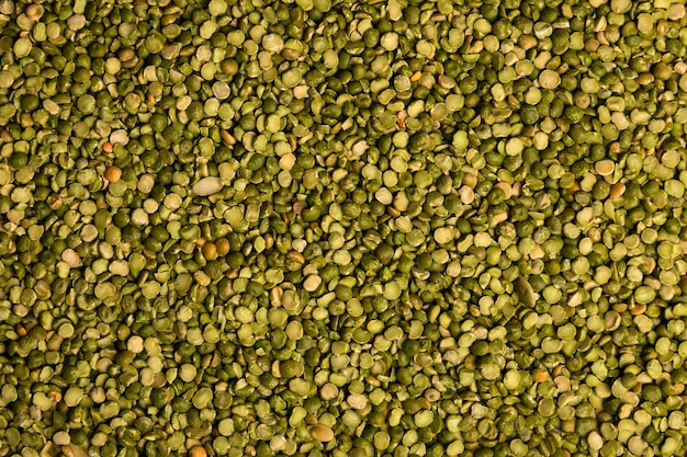 Close-up of uncooked green lentils grains. healthy food concept. lentils background