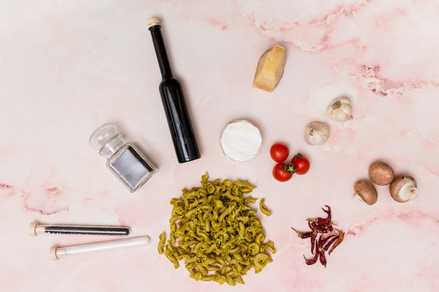 Close-up of uncooked italian pasta surrounded by various ingredients