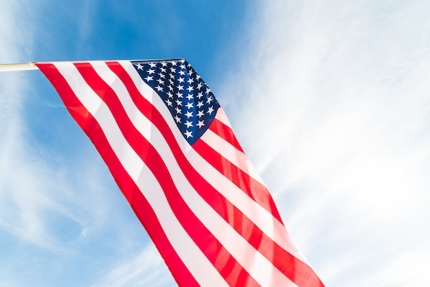 Close up united states of america flag on the blue sky background. .