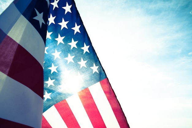 Close up united states of america flag on the blue sky background.