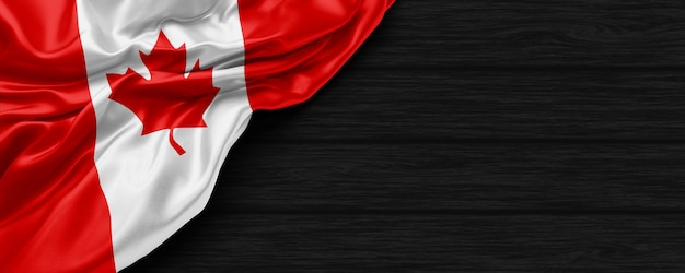 Close up of united states of canada flag on the black wooden background 3d render