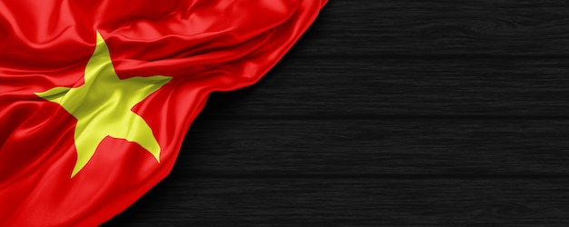 Close up of united states of vietnam flag on the black wooden background 3d render