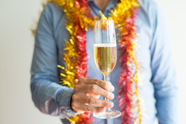 Close-up of unrecognizable man holding full champagne flute