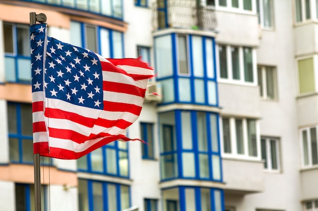 Close up of the us flag against city skyline