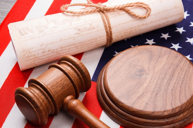 Close-up the usa court concept. wooden hammer with old scroll.