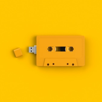 Close up of usb flash drive in vintage yellow audio tape cassette concept illustration iso