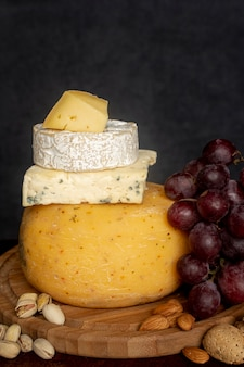 Close-up variety of cheese with grapes