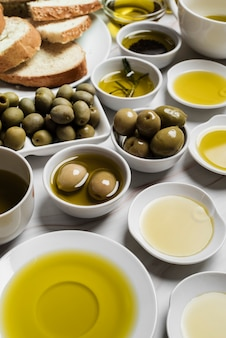 Close-up variety of olive oil and olives