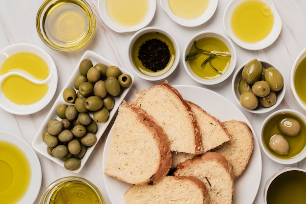 Close-up variety of olives and oil with bread