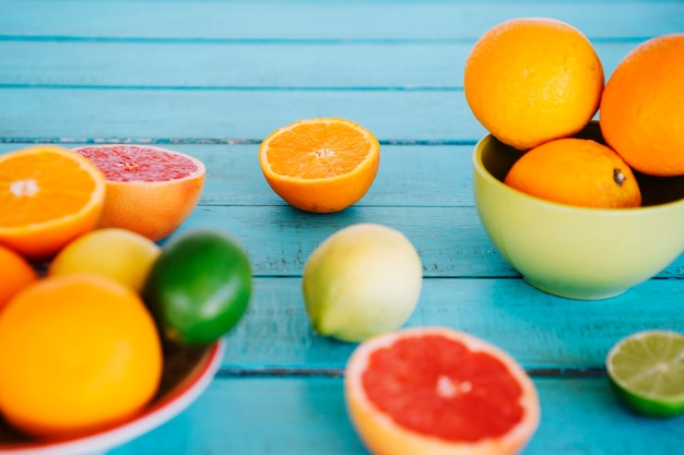 Close-up of various citrus fruits on wooden table top