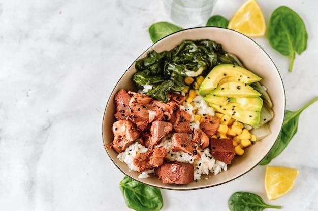 Close up of vegan healthy bowl with rice, salad and jackfruit