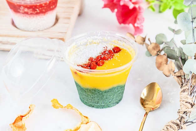 Close up on vegan trifle dessert made with fruit mango spirulina. english cuisine. close up horizontal food photo. gluten free, healthy dessert. vegan food and sweets. snack. copy space