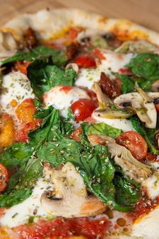Close up of a vegetable pizza. vertical image.