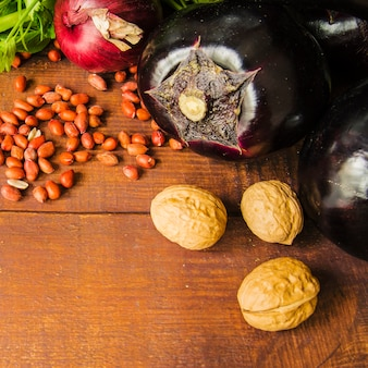 Close-up of vegetables and nuts on wooden table