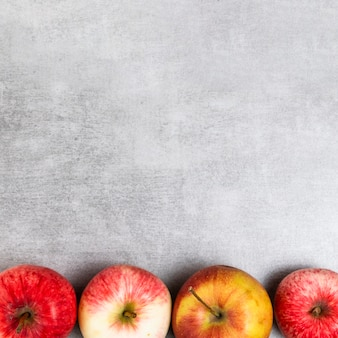 Close-up view of apples on wooden background with copy space