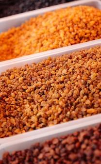 Close-up view of assorted raisins at market