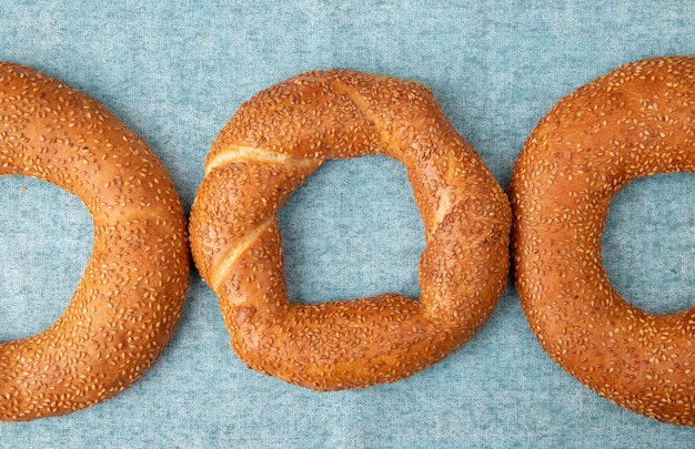 Close-up view of bagels on blue background