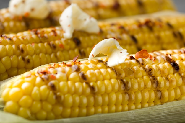 Close-up view of baked corn with butter