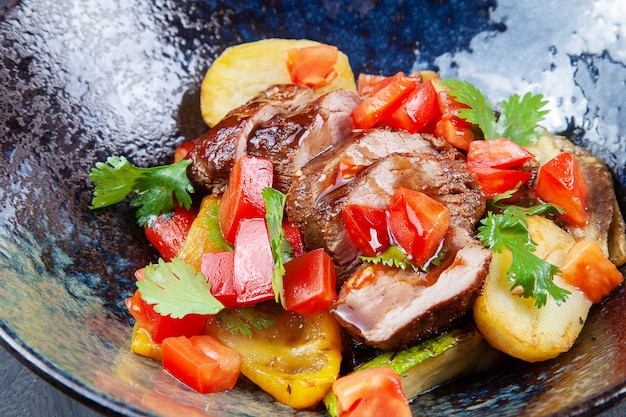 Close up view on baked vegetable and duck breast salad. tasty, healthy meal for dieting menu. salad bowl. food photo for menu or recipe
