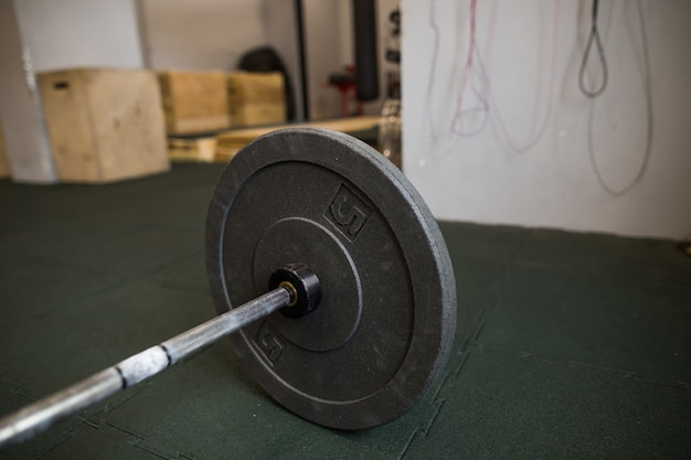 Close up view of barbell on floor in gym