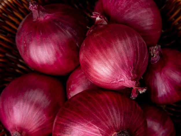 Close-up view of basket of red onions