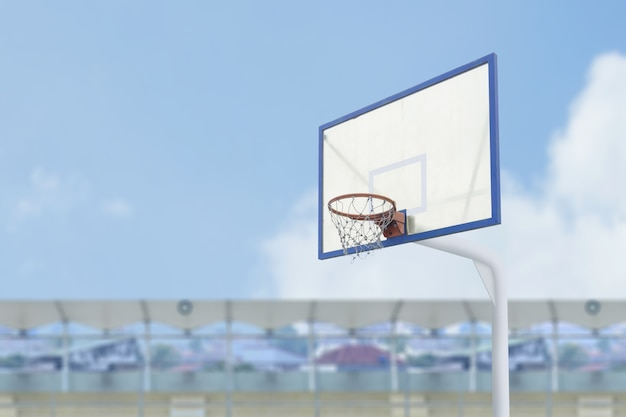 Close up view of the basketball hoop with blue sky background