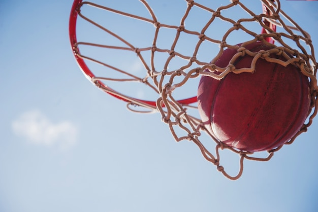 Close up view of basketball and net