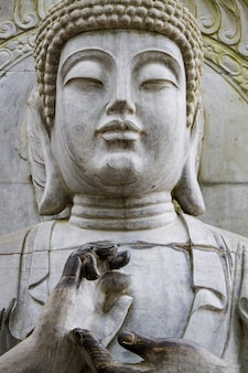 Close up view of a beautiful buddha statue on a park.