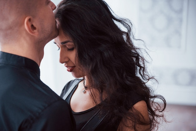 Close up view of beautiful couple. brunette woman is in love with guy