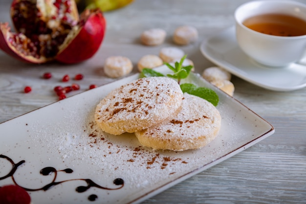 Close up view of beautiful elegant sweet dessert served on the plate. beautiful decoration, restaurant dish, ready to eat. tea time, cozy atmosphere.