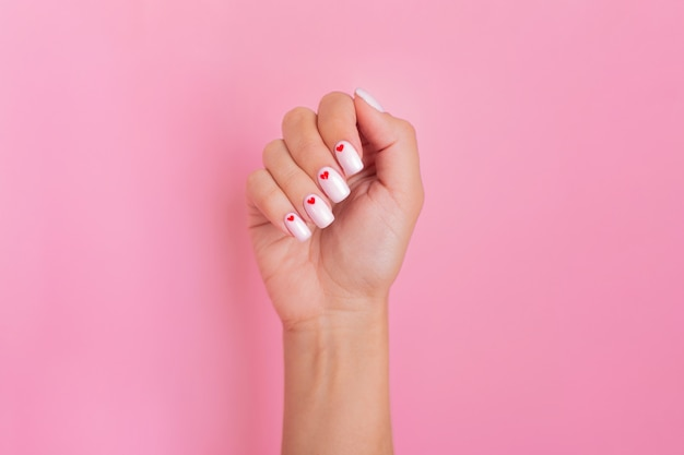 Close up view of beautiful female hand with fashion manicure nails